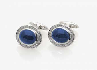 A PAIR OF CLASSIC CUFFLINKS ADORNED WITH SAPPHIRES AND DIAMONDS . Germany