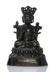 Bronze of a Guanyin on a throne