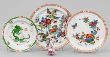 Three decorative plates and a small vase