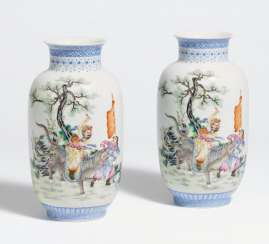 Pair of Chinese lantern vases with warrior on lion and poem