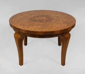 Round table with putt-marquetry.