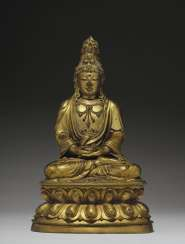 A VERY RARE GILT-BRONZE FIGURE OF SEATED GUANYIN