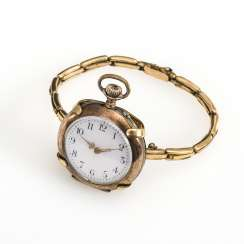 Silver pocket watch in a clasp bracelet