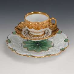 Relief Cup and plate, Meissen.
