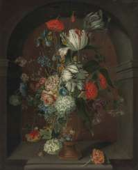Still niche life with flowers in a stone