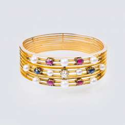 Art Nouveau bangle with old European cut diamonds, sapphires and rubies