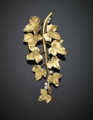 Yellow gold articulated ivy shoot brooch accented with diamonds