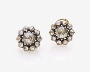 A Couple of the Entourage clip-on earrings with diamond roses