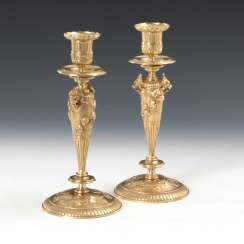 Pair of bronze candlesticks with lions ' heads.