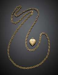 Yellow gold lot comprising a textured chain and a heart shape pendant accented with one diamond