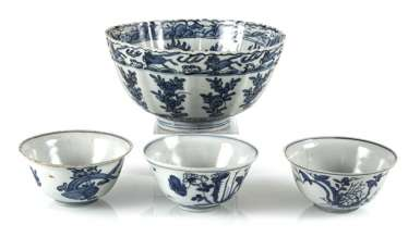 Group the shape of a flower, and three smaller blue-and-white decorated bowls