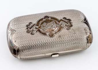 Cigarette box with decorative engraving