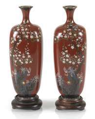Pair of Cloisonné vases with decoration of plum blossoms and lilies on rust red background