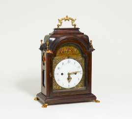 Wooden rococo commode clock with automaton and gilt appliqués