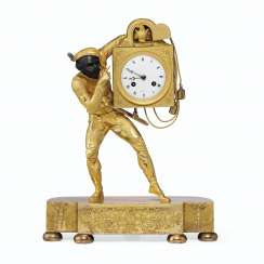 A CHARLES X GILT AND PATINATED BRONZE FIGURAL MANTEL CLOCK