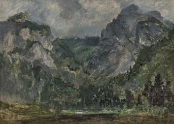 Wooded mountainous landscape with rising weather