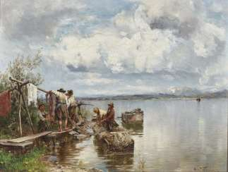 Fishermen with nets on the banks of the Chiemsee