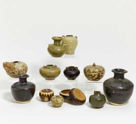 Twelve vases, kendi and lidded boxes