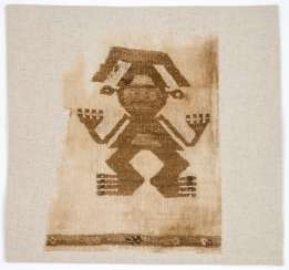 Old Peruvian organic textile part of a shirt with embroidered man motif