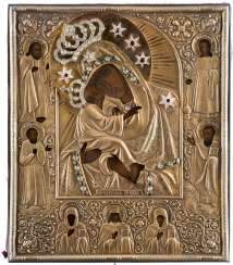 AN ICON SHOWING THE 'POCHAEVSKAYA' MOTHER OF GOD WITH A SILVER-GILT OKLAD WITHIN A FRAME