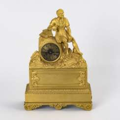 Bronze mantel clock with an antique male figure