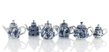 Six blue-and-white decorated teapots