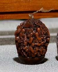 Finely carved walnut with Immortal