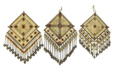 Three large central, one-piece breast ornaments in diamond shape made of partially gold-plated silver