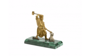 Blacksmith in gilt bronze resting on a block...