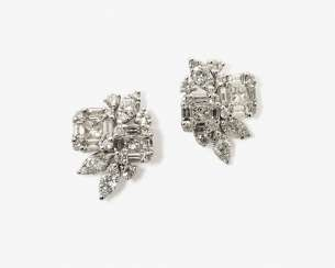 A Couple of stylized floral stud earrings set with diamonds and brilliant-cut diamonds