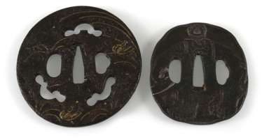 Two Tsuba of iron with a decoration of an elephant and inscription, or Abumi and grasses