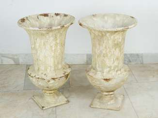Pair of garden urn vases in classical style on quadratic base