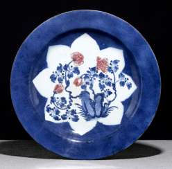 Large powder blue glazed porcelain plate with flowers in copper red