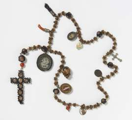 Rosary made from snake vertebrae with pendants