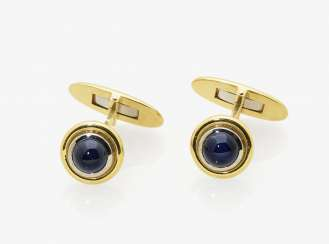 A pair of cufflinks with sapphires, yellow and