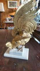 the sculpture of the Golden Cockerel on marble base