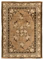 Chinese knotted carpet with floral decor