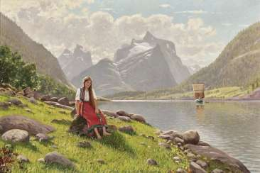 Young Norwegian woman on the bank of a fjord