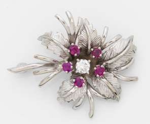 Delicate flower brooch with ruby and diamond trimming