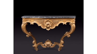 Console gilded wood amounts curved joined by a spacer topped by a shell