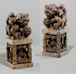 Two large soapstone seal in the Form of Fo lions on pedestals