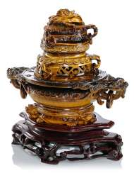 Three-piece incense burner is made of tiger eye on wood base