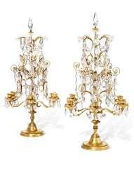 A PAIR OF FRENCH ORMOLU AND CUT AND MOULDED-GLASS SIX-LIGHT CANDELABRA