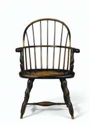 A TURNED AND PAINTED SACK-BACK WINDSOR ARMCHAIR