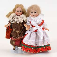 2 small porcelain head dolls.