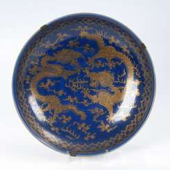 A large plate with a Golden dragon on
