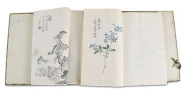 Two volumes with a collection of paintings by Qi Baishi in brocade-covered cassette