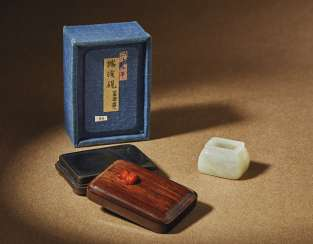 A MINIATURE WHITE JADE WATER POT AND AN INKSTONE