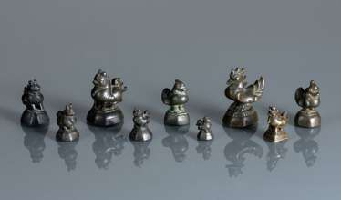 Group of nine opium weights, made of Bronze in bird or animal form
