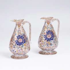 Pair of glass carafes with arabesques